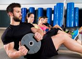 stock photo of heavy equipment  - Abdominal plate training core group at gym fitness workout - JPG