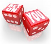 Bet On You words on two red dice self confidence and following your dreams