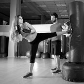 Boxing aerobox blond girl with personal trainer man at fitness gym