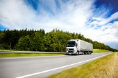 stock photo of semi trailer  - Truck delivery cargo on the highway in motion - JPG