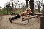 Tough Young Woman Doing Pushups