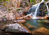 foto of cataract  - Deep forest waterfall at Geres National Park - JPG