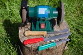 Electric Sharpening Device Knives On Stump Outdoor