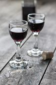 Glass Of Cherry Liqueur On Wooden Table