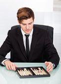 Businessman Playing Backgammon
