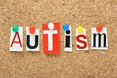 image of autism  - The word Autism in cut out magazine letters pinned to a cork notice board - JPG