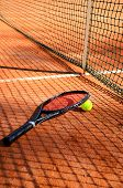Tennis Ball And Racket Are Near The Net Vertical