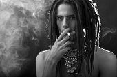 Black And White Profile Portrait Of A Young Man With Dreadlocks