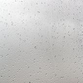 Rain Drops On Window Pane In Cloudy Day