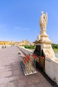 image of archangel  - San Rafael Archangel statue in the Roman bridge Cordoba Andalusia Spain - JPG