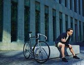 image of bicycle gear  - Stylish young man with classic bicycle - JPG