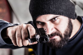 foto of gangsta  - a bearded criminal pointing a pistol and wearing a beanie hat isolated over white - JPG