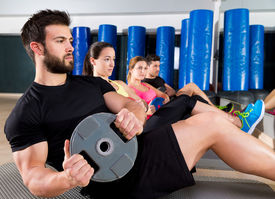 foto of abdominal  - Abdominal plate training core group at gym fitness workout - JPG