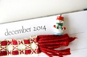 picture of last day work  - close up december page on calendar with festive decoration - JPG