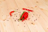 Bunch of fresh cayenne red pepper on wood table