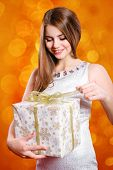 Beautiful girl with long hair with gift box