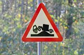 image of hump  - Lorry hump red triangle warning sign uk - JPG