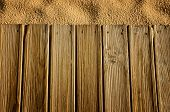 Wooden boards and sand, background