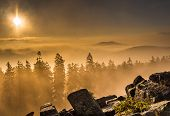 Panoramic view on mountains covered with morning mist