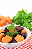 Orange And Purple Carrots With Green Parsley
