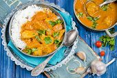 image of curry chicken  - Pumpkin curry with chicken on wooden background - JPG