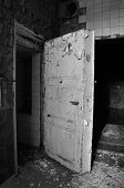 Old Door In An Abandoned Brewery
