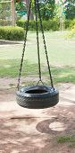 foto of tire swing  - one tire and chain swing in play ground - JPG
