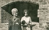 LODZ, POLAND, CIRCA SIXTIES - Vintage photo of two women and a little girl outdoor