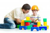 Boy and father play builders