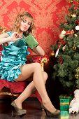 Woman Near The Christmas Tree