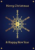 stock photo of christmas theme  - Elegant golden snowflake on a deep blue background - JPG