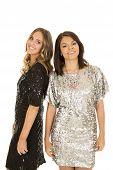 Two Woman Shiny Dresses Smiling