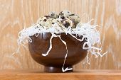 Quail Eggs Lying In A Wooden Bowl