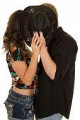Man Black Shirt Woman Both Behind Hat Kiss