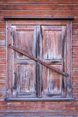 image of wainscoting  - Vintage closed wooden window on old wall - JPG