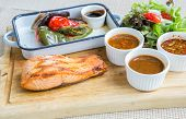 salmon steak with grilled vegetable and assorted sauce