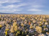 aerial view of Fort Collins residential area, typical along Colorado Front Range, late fall  (November) scenery, foothills of ROcky Mountains in background