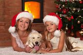 Christmas with our doggy - woman and little girl and the family pet