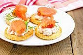 Crackers with cream and salmon on board