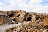 stock photo of gory  - Uplistsikhe cave complex is an ancient cave city near Gori in Georgia - JPG