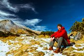 stock photo of saddening  - climber reaches the top in the Carpathian mountains - JPG