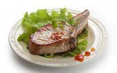 picture of pork cutlet  - Fried pork cutlet with fresh green lettuce on the plate - JPG