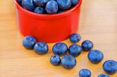Blueberry in red can on a wooden table