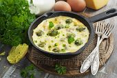 Casserole With Brussels Sprouts And Cheese In A Frying Pan