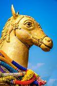 A golden horse statue