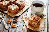 foto of walnut  - oatmeal cake with dates and walnuts on a dark wood background - JPG