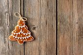 Christmas homemade gingerbread cookie over wooden background