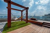 Roof Terrace With Hammock On A Sunny Day