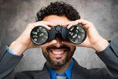 picture of binoculars  - Businessman using binoculars - JPG
