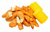 image of sweet-corn  - Breaded chicken strips and potato wedges with sweet corn cobs isolated on a white background - JPG